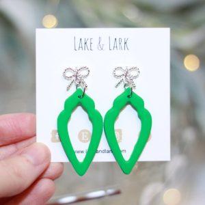fancy bow green teardrop earrings